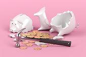 Broken piggy bank with hammer on pink background