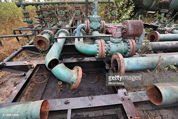 Broken pipework sits at an abandoned oil flow station operated by Royal Dutch Shell Plc in KDare Nigeria on Wednesday Jan 13 2016 Twenty years after...
