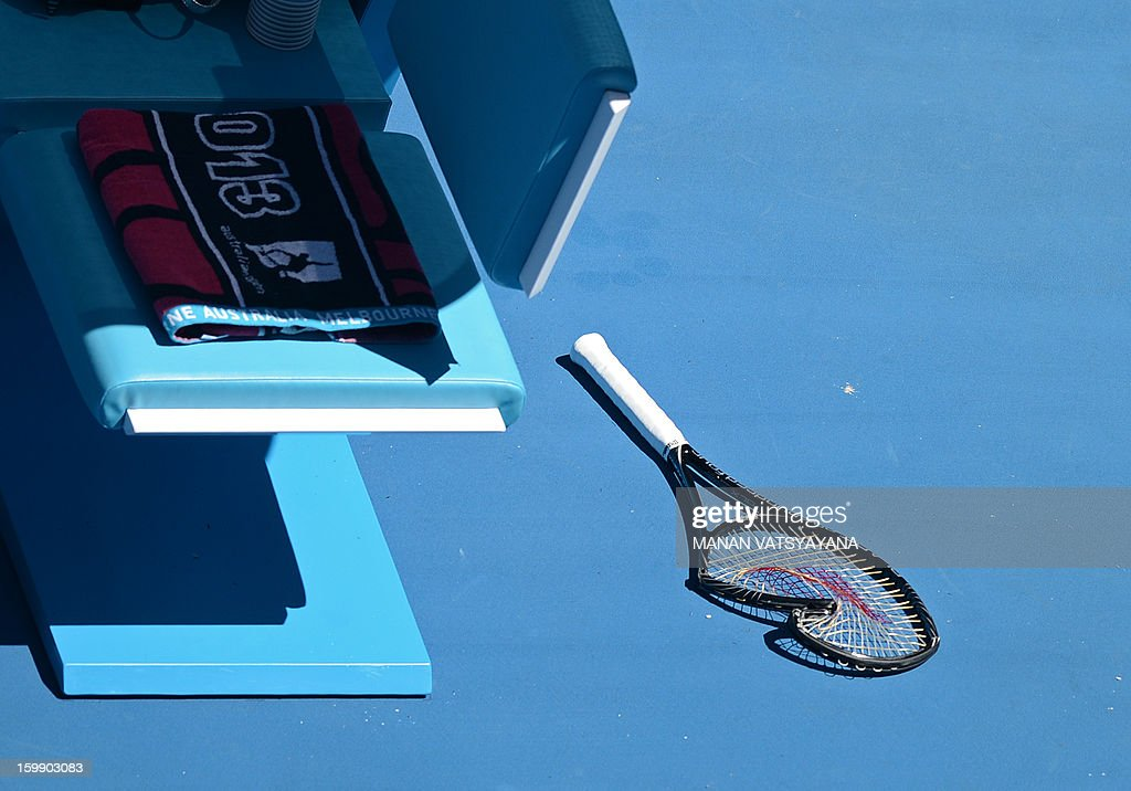 A broken racquet from Serena Williams of the US is seen during her women's singles match against Sloane Stephens of the US on day ten of the Australian Open tennis tournament in Melbourne on January 23, 2013.