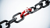 Broken red chain part among metal parts.