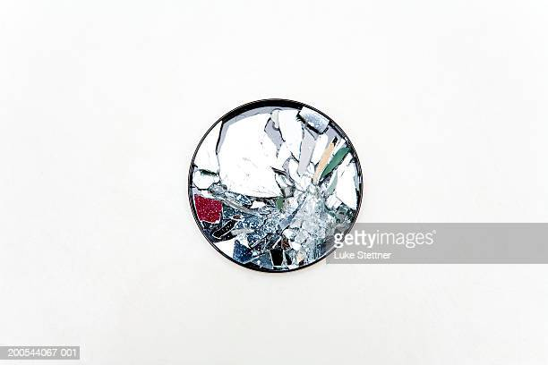 Broken round mirror, close-up