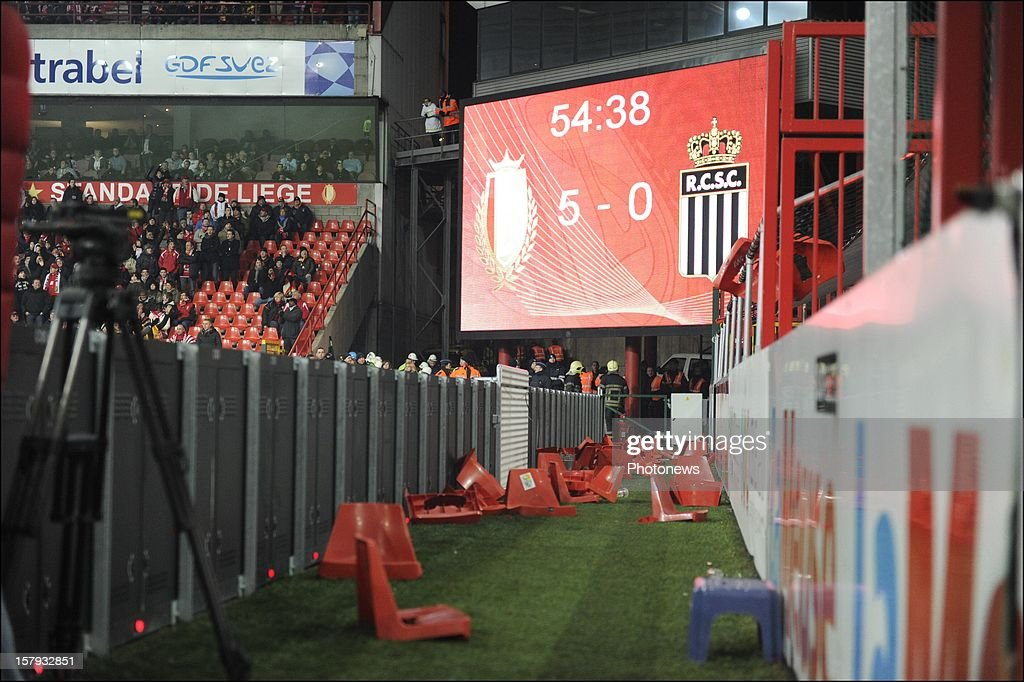 Broken seats thrown by SC Charleroi supporters litter the side of the pitch during the Jupiler League match between Standard de Liege and Sporting Charleroi on December 7, 2012 in Liege, Belgium.
