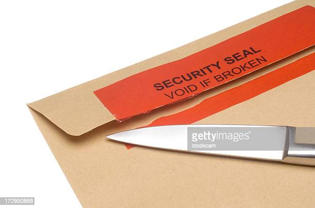 Broken security seal with knife