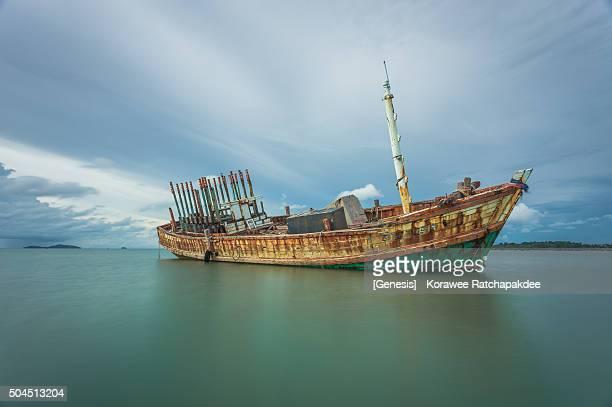 Broken ship abandoned in the sea