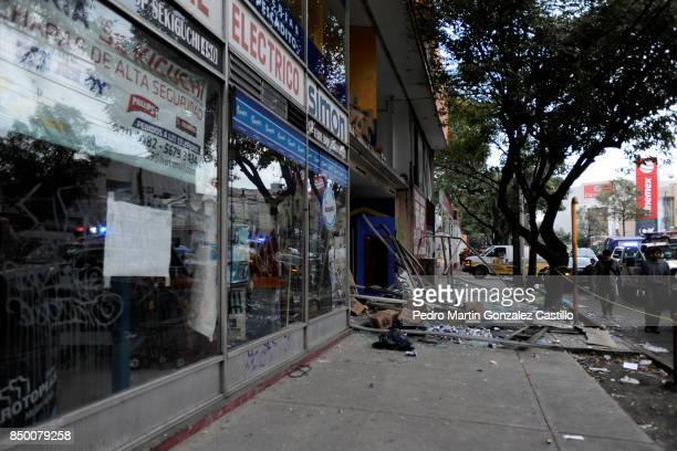 A broken sotre window is seen after the magnitude 71 earthquake jolted central Mexico damaging buildings knocking out power and causing alarm...