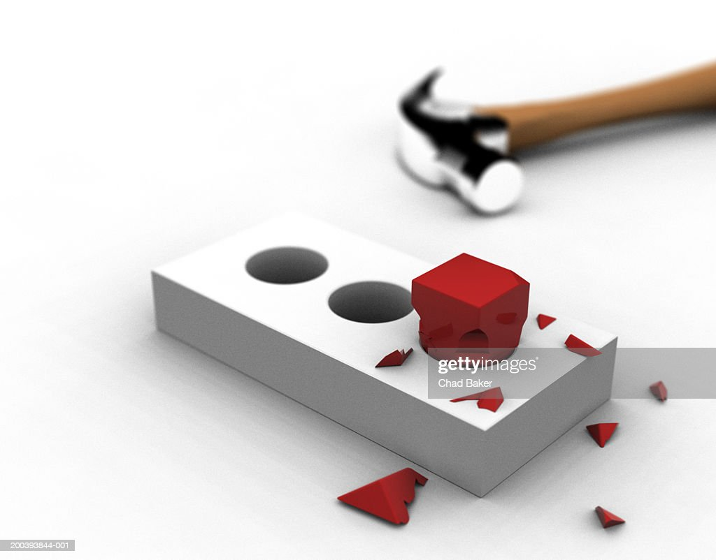 Broken square peg in round hole with hammer : Stock Photo