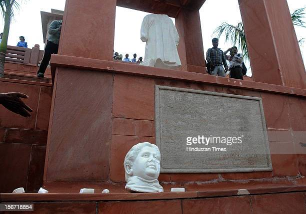 'LUCKNOW INDIA JULY 26 Broken statue of exChief Minister Mayawati is lying after the Uttar Pradesh Navnirman Sena activitists allegedly attacked the...