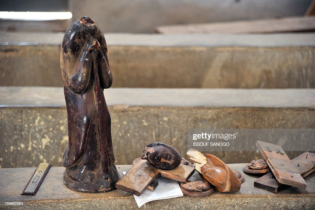 A broken statue of Virgin Mary is left on the ground of a Catholic church in Diabaly, on January 22, 2013. The EU executive today announced 20 million euros of extra humanitarian aid to help tens of thousands of Malians fleeing fighting in the nation's north and centre, its second such donation in as many months.