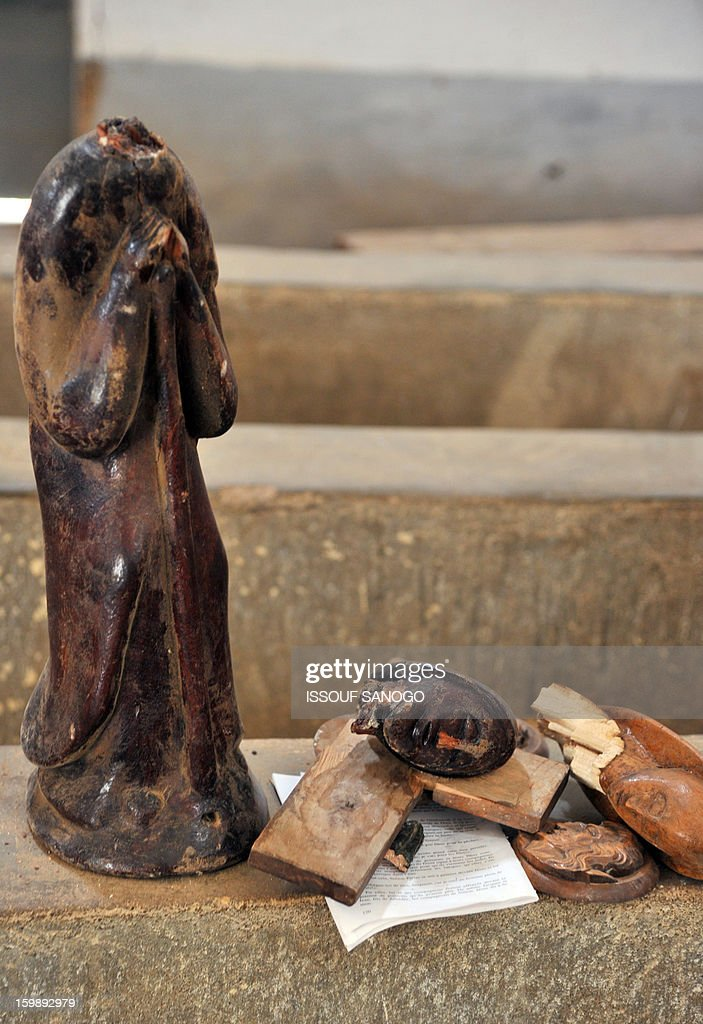 A broken statue of Virgin Mary is left on the ground of a Catholic church in Diabaly, on January 22, 2013. The EU executive today announced 20 million euros of extra humanitarian aid to help tens of thousands of Malians fleeing fighting in the nation's north and centre, its second such donation in as many months. AFP PHOTO / ISSOUF SANOGO