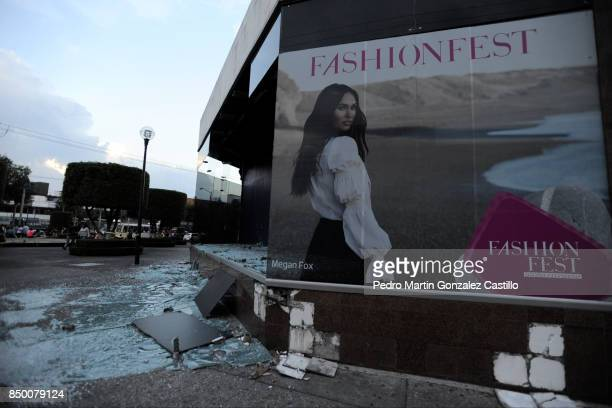 A broken store window is seen after the magnitude 71 earthquake jolted central Mexico damaging buildings knocking out power and causing alarm...