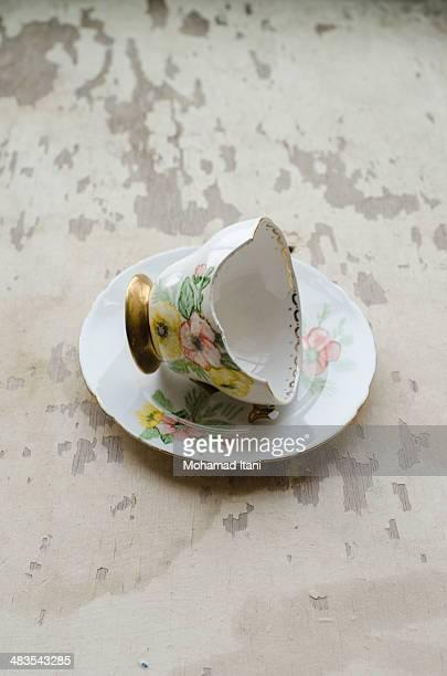 Broken teacup and saucer
