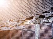 broken tile roof after rain strom.