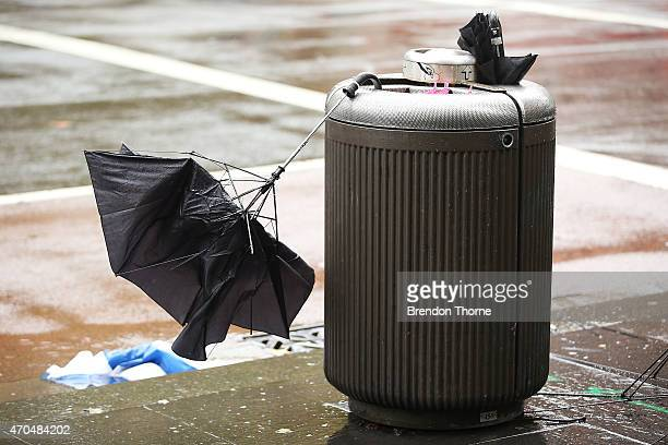 A broken umbrella is abandoned in the CBD on April 21 2015 in Sydney Australia A second day of damaging winds and heavy rain have hit the New South...