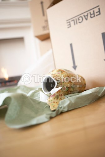 Broken Vase Lying On Floor By Box Stock Photo Thinkstock