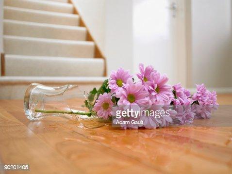 broken vase of flowers on floor stock photo getty images - Broken Glass Vase