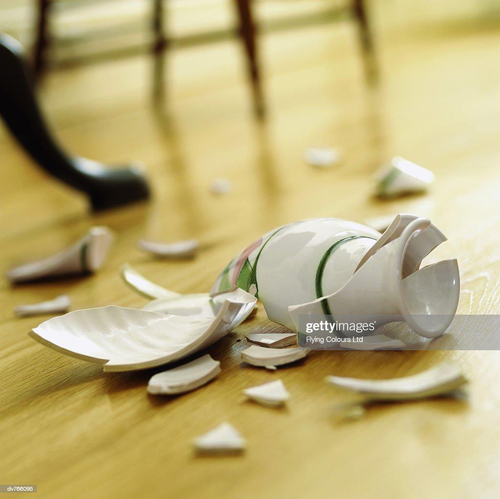 Broken Vase on a Wooden Floor : Stock Photo