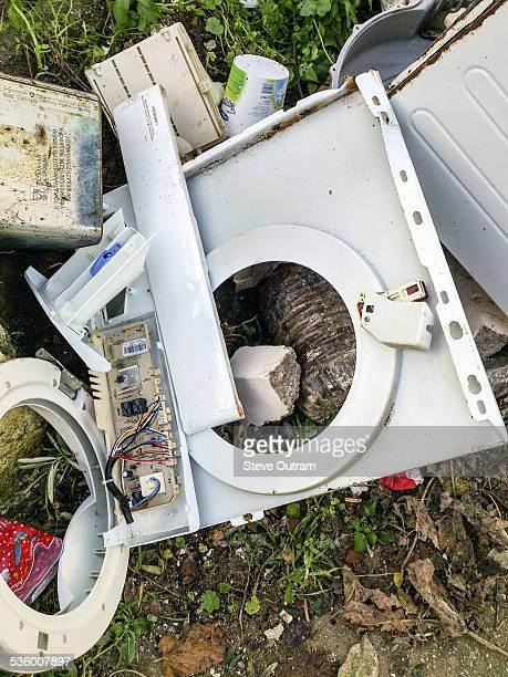 Broken washing machine on rubbish tip
