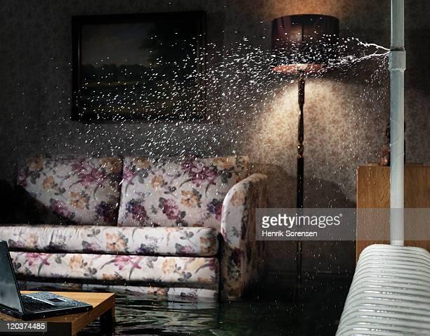 broken water pipe in flooded room