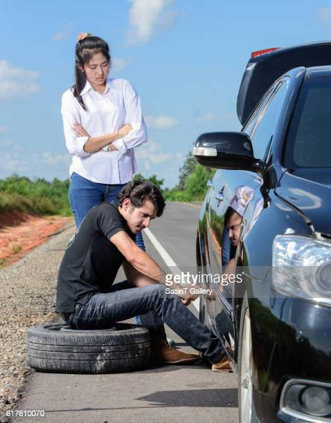 Broken wheel man changing tire