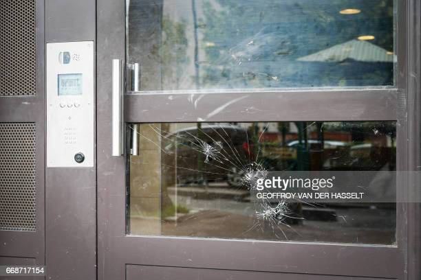 A broken window is seen on the door of an HLM building that is part of the HLM housing estate of AulnaysousBois a commune in the SeineSaintDenis...