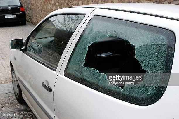 Broken window of automovil by presumed delinquents in Cuenca Spain