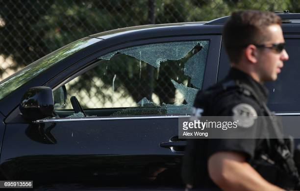 A broken window on a vehicle is seen outside Eugene Simpson Stadium Park where a shooting took place on June 14 2017 in Alexandria Virginia US House...