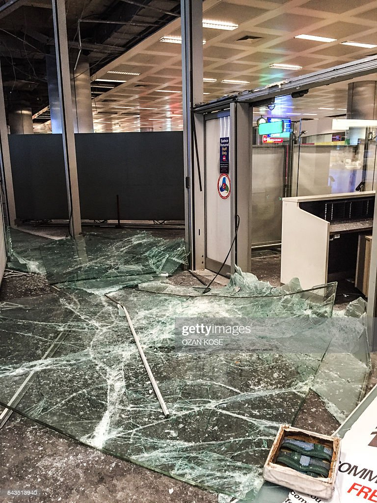 Broken windows are pictured at the attacks and explosions site in Ataturk airport's international arrivals terminal on June 29, 2016, a day after a suicide bombing and gun attack targeted Istanbul's airport, killing at least 36 people. A triple suicide bombing and gun attack that occurred on June 28, 2016 at Istanbul's Ataturk airport has killed at least 36 people, including foreigners, with Turkey's prime minister saying early signs pointed to an assault by the Islamic State group. / AFP / OZAN