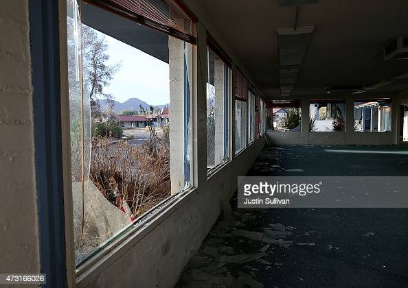 Broken windows are seen in an abandoned hotel near Boulder Beach on May 13 2015 in Lake Mead National Recreation Area Nevada As severe drought grips...