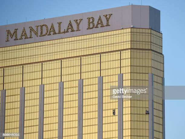Broken windows are seen on the 32nd floor of the Mandalay Bay Resort and Casino after a lone gunman opened fire on the Route 91 Harvest country music...