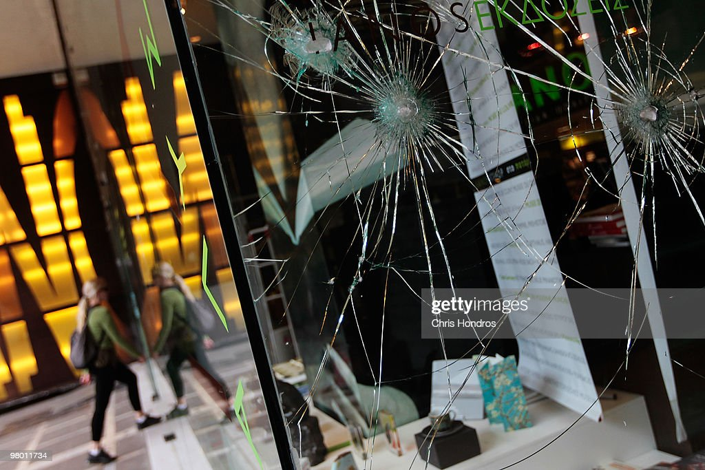 Broken windows from recent rioting protesting government financial austerity measures are seen at a department store on March 24, 2010 in central Athens, Greece. Higher prosperity made its way to once-unfashionable Greece in the last 15 years since the small country began reforming its economy to join the euro zone. But some argue that Greece overextended itself, and fellow European nations negotiated March 24 over what role the International Monetary Fund could play in European Union efforts to alleviate Greece's debt crisis. Greece's debt and economic woes have prompted forced austerity measures as a condition of staying in the European Union, and EU-heavyweight Germany has opposed a bailout of the fragile, debt-ridden Greek economy.