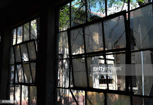 Broken windows remain open in one of the buildings of the The Ellis Island Hospital August 5 a 750bed facility which treated over 12 million patients...