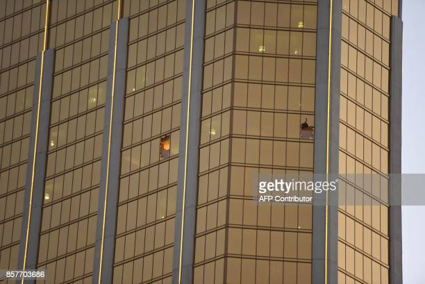 Broken windows that Stephen Paddock fired from in the The Mandalay Bay Hotel and Casino are seen in Las Vegas Nevada is seen October 4 2017 The...
