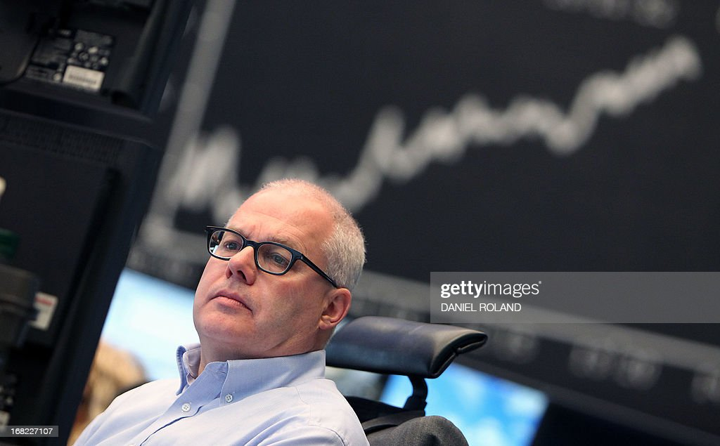 A broker is seen in front of the German Stock Market Index DAX at the stock exchange in Frankfurt, Germany, on May 7, 2013. Germany's blue-chip DAX 30 stock index topped an all-time intraday high in late morning on Tuesday, propelled by a raft of favourable corporate earnings reports, traders said.