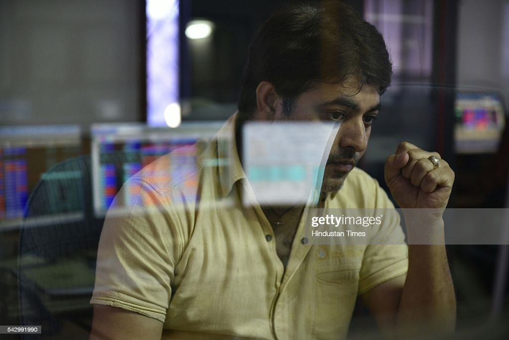 broker looks at his computer screen displaying the Sensex after Britain's exit from the European Union (EU), on June 25, 2016 in Mumbai, India. Britain voted to break away from the European Union on Friday, shattering the unity of a 60-year-old continental bloc, prompting the exit of Prime Minister David Cameron and rattling the world of finance and business. In India, shares fell more than 4% on the news but recovered by half after authorities moved to calm investor worries. The benchmark BSE ended 2.2% down, its biggest single-day percentage fall since February.