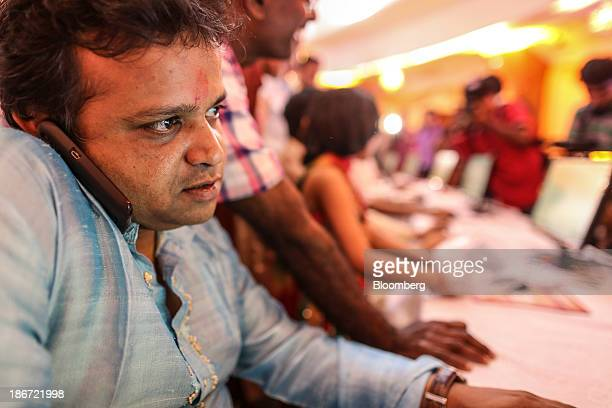 A broker speaks on his mobile phone as ceremonial purchases of stocks are made during the session marking Diwali at the Bombay Stock Exchange in...