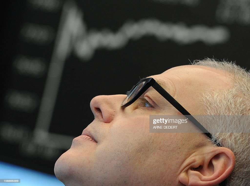 A broker views his monitor at the Stock Exchange in Frankfurt am Main, on January 2, 2013. Financial markets worldwide eased after the United States averted the so-called fiscal cliff. The German Stock Index (Dax) rose by about two per cent on the first trading day 2013. AFP PHOTO / ARNE DEDERT /GERMANY OUT