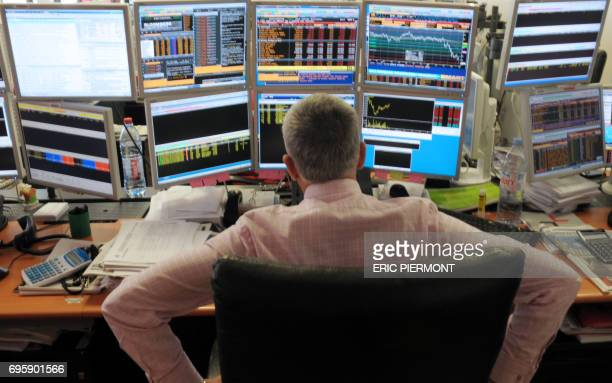 A broker watches screens in an office of the French investment company Aurel BGC in Paris on September 12 2011 The French stock market plunged by 427...