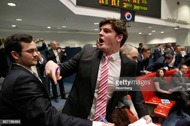 Brokers and clerks shout and gesture on the trading floor of the open outcry pit at the London Metal Exchange on the last day of trading at their...