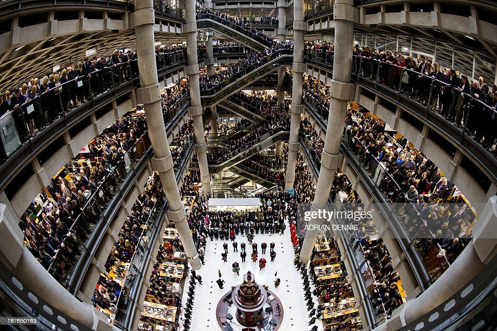 Brokers and underwriters line the balconies and escalators of the Lloyd's of London building in central London on November 11 during a twominute...