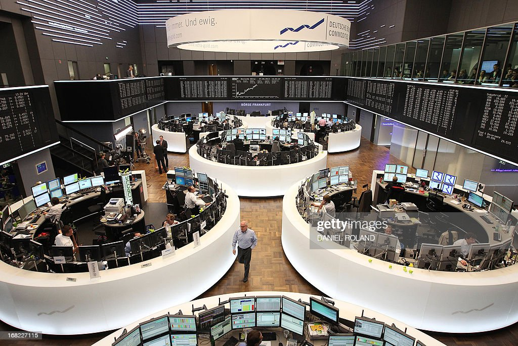 Brokers are seen at the stock exchange in Frankfurt, Germany, on May 7, 2013. Germany's blue-chip DAX 30 stock index topped an all-time intraday high in late morning on Tuesday, propelled by a raft of favourable corporate earnings reports, traders said.