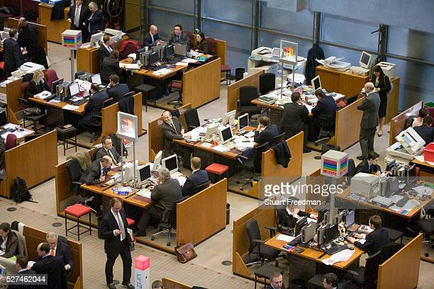 Brokers at their desks in Lloyds of London The trading floor at Lloyds is the world's leading insurance market where It serves as a meeting place...
