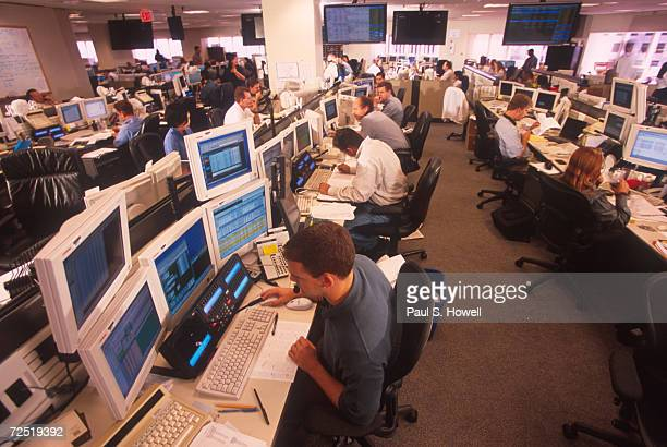 Brokers field calls on Enron's trading floor which trades and brokers packages of energy making billions in the ptocess August 17 2000 in Houston...