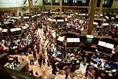 Brokers in floor of New York Stock Exchange