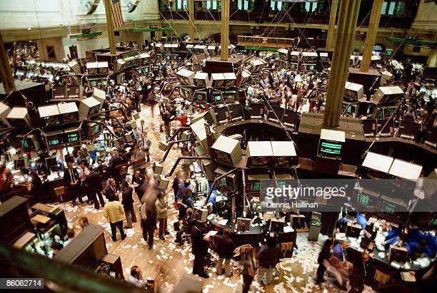 Brokers in floor of New York Stock Exchange