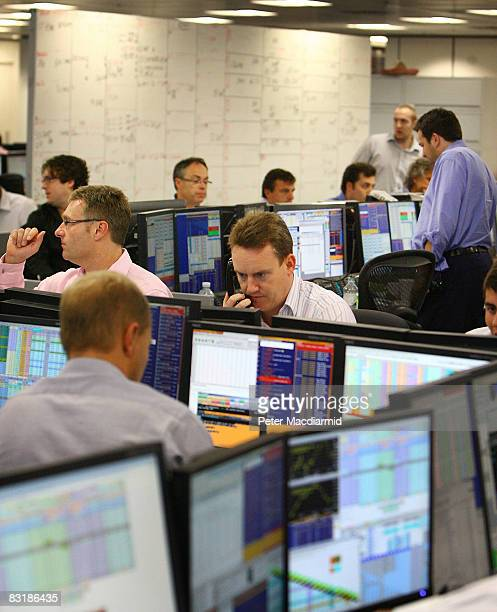 Brokers on ICAP's dealing floor look at prices on their screens on October 9 2008 in London Share prices are up on the day as markets react to the...