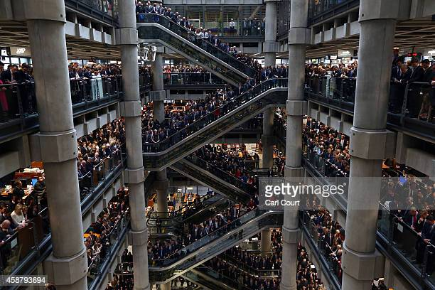 Brokers underwriters and dignitaries hold a twominute silence during a Remembrance Day service at the Lloyd's of London building on November 11 2014...