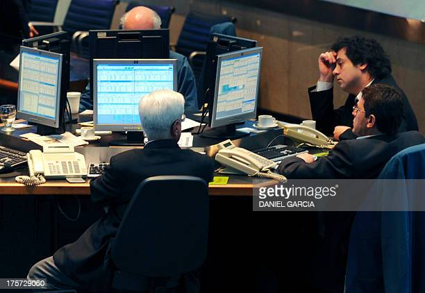 Brokers watch the computer's screens at Buenos Aires' stock exchange on September 16 as the Argentine stock exchange goes down 117 percent in the...