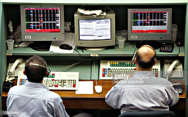 Brokers works at the Istanbul Stock Exchange in Istanbul 30 April 2007 The Turkish lira tumbled early 30 April 2007 in line with heavy losses on the...