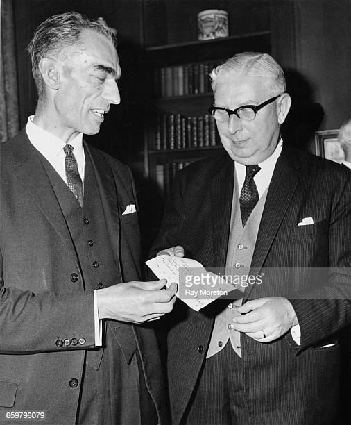 AF Bromige Secretary of the Queen Elizabeth Hospital for Children Research Appeal Trust presents a cheque for 350 thousand pounds to British...
