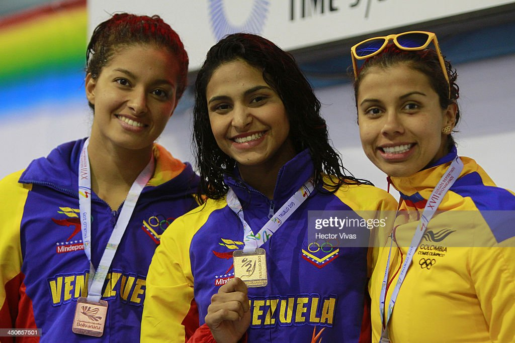 Bronce medalist Brika Torrellas of Venezuela, gold medalist Jeserik Pinto of Venezuela and silver medalist Carolina Colorado of Colombia pose during the 50 meter backstroke event ceremony as part of the XVII Bolivarian Games Trujillo 2013 at pools complex of Mansiche Stadium on November 19, 2013 in Trujillo, Peru.